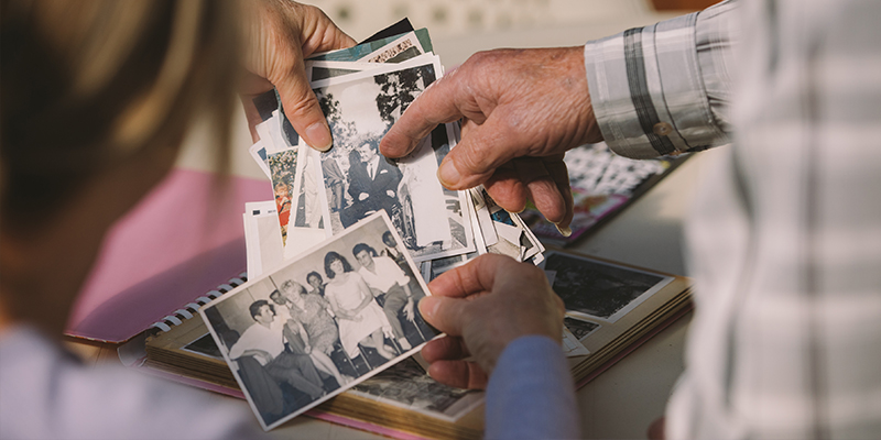 Colleen Inglis, black and white family photos, looking at photos, photo album, Care Worker story, HammondCare, home care,
